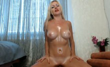 Busty Blonde Oils herself and Rides her Toy